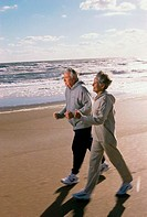 Senior couple walking on the beach
