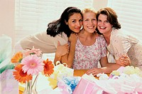 Portrait of three young women at a baby shower
