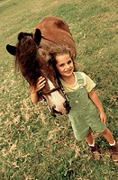 Portrait of a girl standing with a horse (thumbnail)