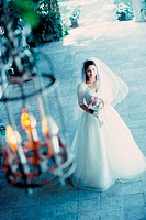High angle view of a bride holding a bouquet of flowers (thumbnail)