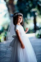 Side profile of a flower girl smiling