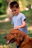 Boy petting his dog