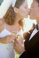Close-up of a newlywed couple kissing