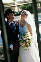 Newlywed couple laughing together