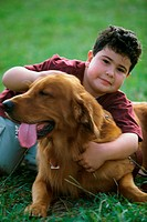 Portrait of a boy hugging his dog