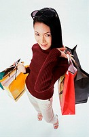 High angle view of a young woman carrying shopping bags
