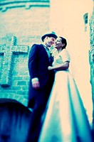 Low angle view of a newlywed couple standing in front of a church