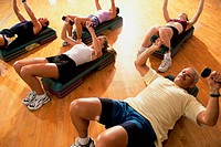 High angle view of a group of people exercising in a step aerobics class