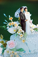 Figures of a bride and groom on a wedding cake