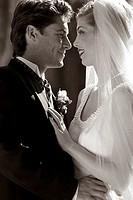 Side profile of a newlywed couple looking at each other