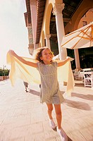 Front view of a girl running with a shawl (thumbnail)