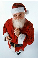 High angle view of Santa Claus looking at the camera