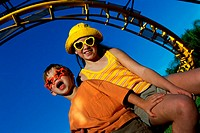 Low angle view of a boy and a girl in an amusement park