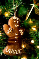Close-up of a gingerbread cookie on a Christmas tree