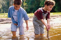 Two boys playing in water
