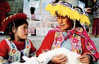 Indian mother and daughter. Cuzco. Peru.