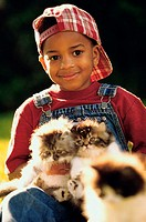 Close-up of a boy holding cats