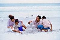 Parents with their son and daughter on the beach