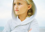 Girl wearing hooded sweatshirt