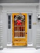 Christmas decorations on door. Amherst, Massachusetts. USA