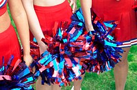Mid Section View of Three Cheerleaders