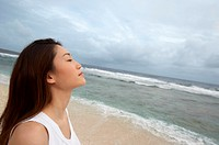 Profile of a Woman Standing on a Beach With Her Eyes Closed