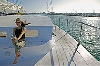 Woman sitting on a catamaran while sailing in Key West, Florida. December 2004