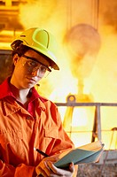 Technician and furnace in foundry, steel industry. Biscay, Euskadi, Spain