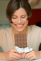 Woman holding a bar of chocolate (grainy effect, 1)