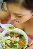 Woman eating Asian glass noodle soup (1)