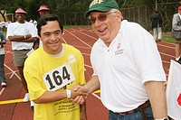 Mentally disabled, volunteers, track event. Special Olympics Summer Games, FIU, North Miami, Florida. USA.