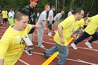 Mentally disabled, starting line, foot race, volunteers. Special Olympics Summer Games, FIU, North Miami, Florida. USA.