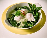 Poached eggs on spinach with herb sauce
