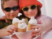 Two children with ice cream cones
