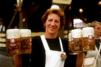 Waitress with full tankards of beer at Oktoberfest