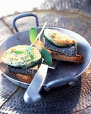 Grilled cucumber with goat's cheese and poppy seeds