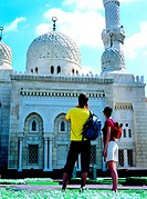 Western tourists at Jumeirah Mosque in Dubai, United Arab Emirates