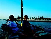Western couple doing an abra tour on the creek in Dubai, United Arab Emirates