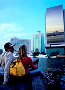 Western tourists doing a boat tour on the creek in Dubai, United Arab Emirates