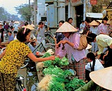 Vendors offering fresh vegetables for sale, Vietnam