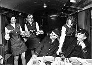 Left to right: Marie Spencer, Dianna Bunyan and Margaret Liddle, practising serving meals to BR workers George West (left) cleaning supervisor, and Er...