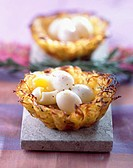 Potato nests filled with soft-boiled quail eggs