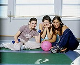 Portrait of three women in gym
