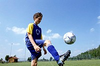 young footballer bouncing the ball