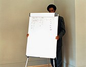 Businessman hiding behind flipchart