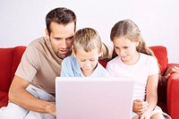 Father and children using laptop (thumbnail)