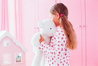 Girl hugging her teddy bear