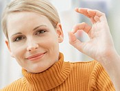 Woman giving OK sign