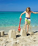 Boy smashing sandcastles