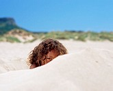 Girl hiding in the sand